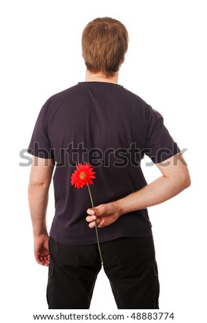 young man hid behind a flower gerbera. isolation - stock photo