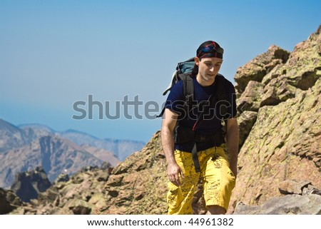 Young man hiking on the cliff