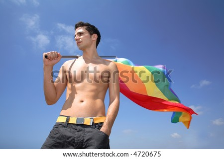 Young man hold a rainbow flag guy boy - stock photo
