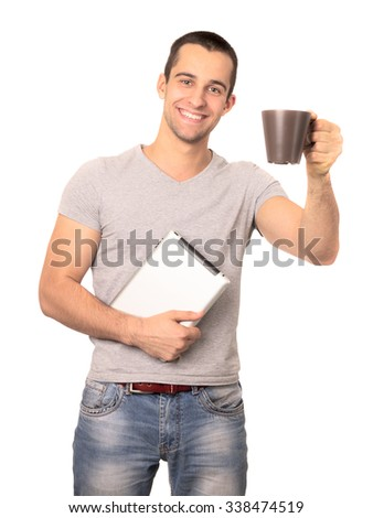 Young man hold digital tablet computer and cup of coffee. Isolated on white background. - stock photo