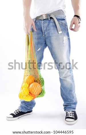 Young man holding a bag with food isolated over white background - stock photo