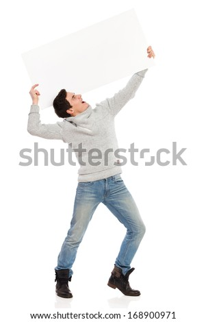 Young man holding a banner and screaming. Full length studio shot isolated on white. - stock photo