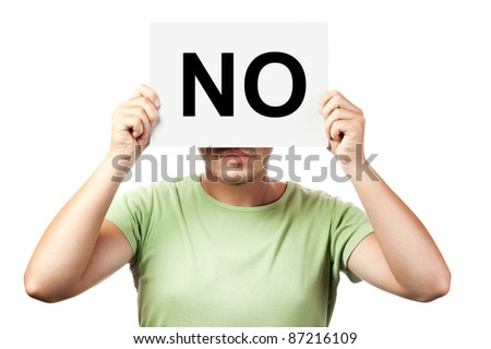 young man holding a billboard with word no isolated on white background - stock photo