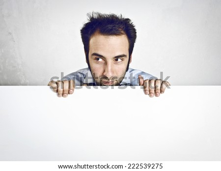 Young man holding a blank board - stock photo