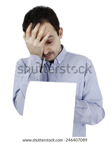 Young man holding a blank piece of paper - stock photo