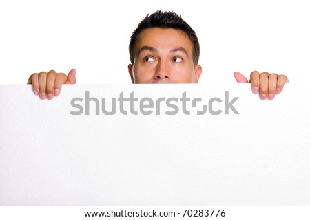 Young man holding a blank white board - stock photo