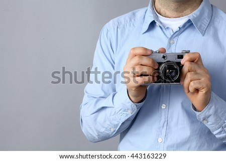 Young man holding a camera .