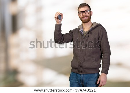 Young man holding a car key - stock photo