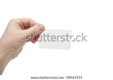 Young man holding a credit card, or white business card, or pointing to the right - stock photo