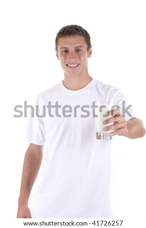 Young man holding a glass of milk on white.