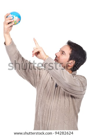 young man holding a globe on his hand and pointing - stock photo