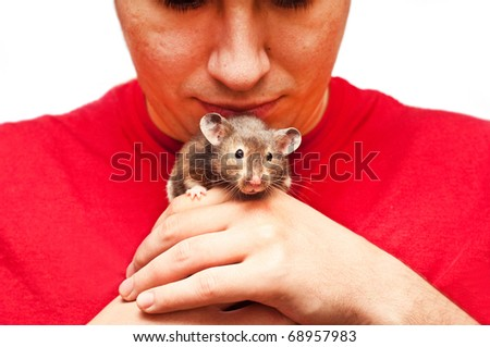 Young man holding a hamster - stock photo