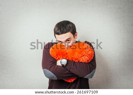 young man holding a heart - stock photo