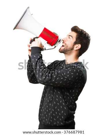 young man holding a megaphone - stock photo