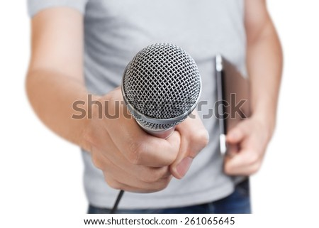 Young man holding a microphone, isolated on white background - stock photo