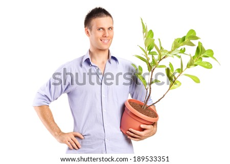 Young man holding a plant isolated on white background - stock photo