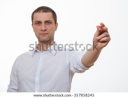 Young man holding a red pen, white background