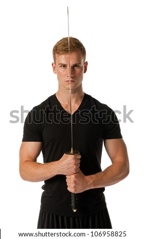 Young man holding a samurai sword isolated on a white background. - stock photo