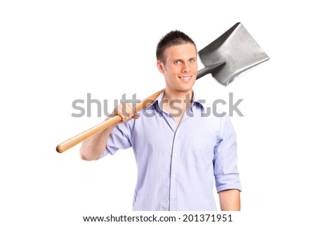 Young man holding a shovel isolated on white background