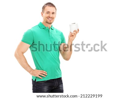 Young man holding a single roll of toilet paper isolated on white background - stock photo