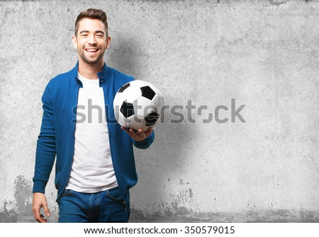 young man holding a soccer ball - stock photo