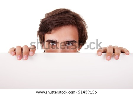 Young man holding a white board, looking to camera, isolated on white background - stock photo