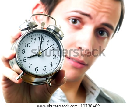 Young man holding an alarm clock - stock photo