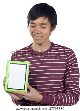 Young man holding an empty picture frame