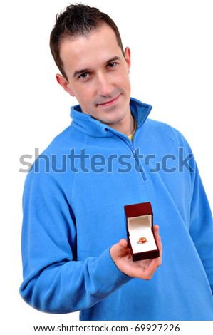 Young man holding and ring - stock photo