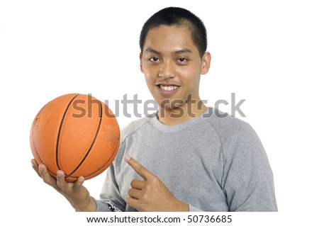 Young man holding basketball over white