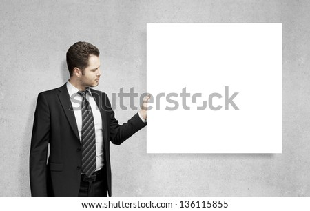 young man holding blank card - stock photo