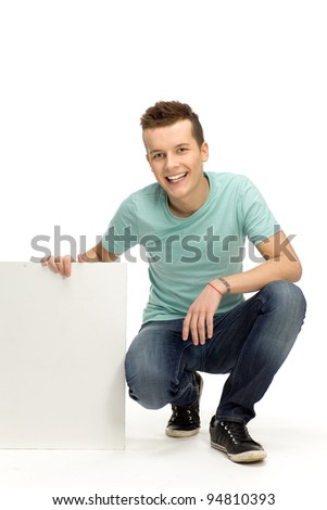 Young man holding blank placard - stock photo