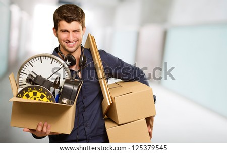 Young Man Holding Card boxes Gesturing, Indoor - stock photo