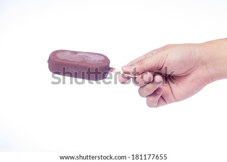 Young man holding chocolate popsicle, isolated on white background. - stock photo