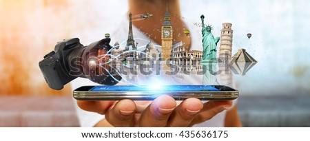 Young man holding digital camera taking shoots of famous monuments of the world - stock photo