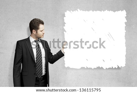 young man holding drawing card - stock photo