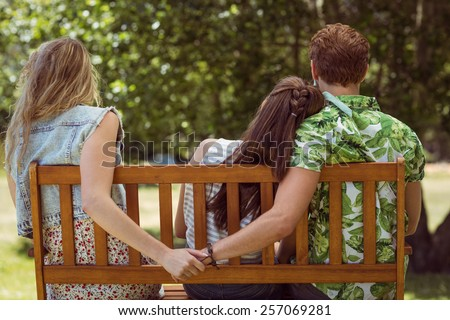 Young man holding hand of wrong girl on a summers day - stock photo