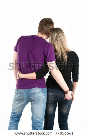 young man holding hand on girlfriend jeans - stock photo