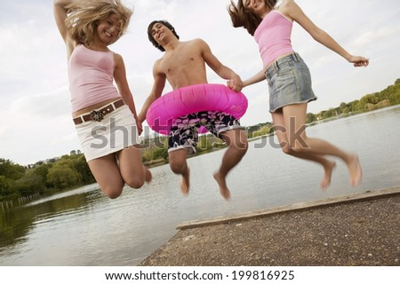 Young man holding hands with jumping - stock photo