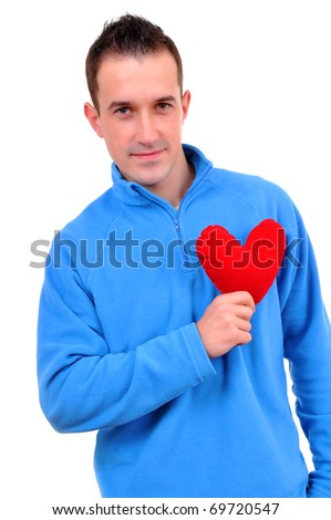 Young man holding heart - stock photo
