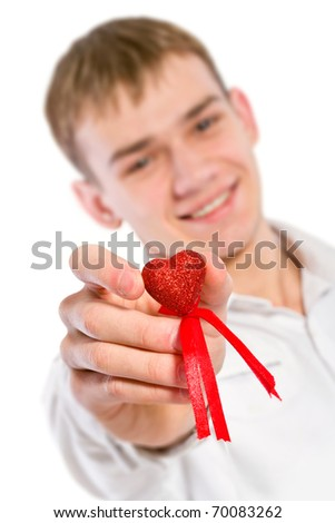 Young man holding heart in his hand. - stock photo