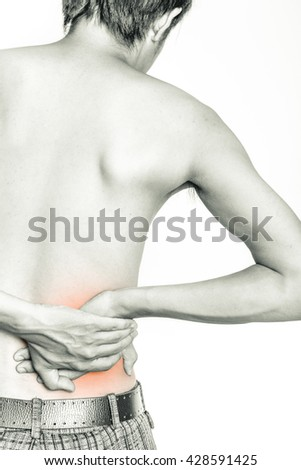 Young man holding his back in pain, isolated on white background, monochrome photo - stock photo