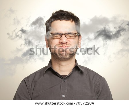 Young man holding his breath among black clouds (pollution, anxiety, environmental concept and more)