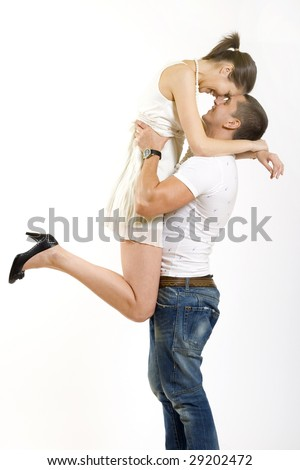 young man holding his girlfriend in the air - stock photo