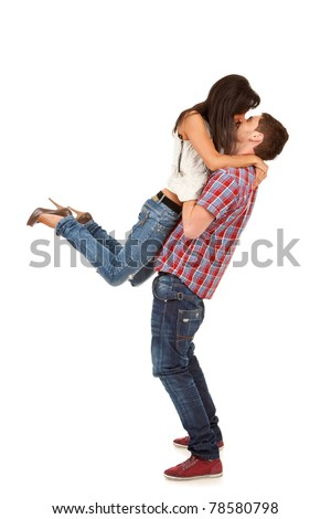young man holding his girlfriend in the air over white - stock photo