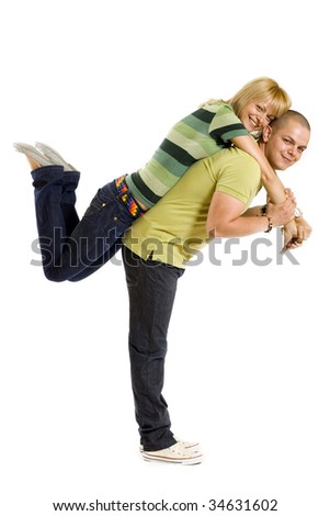 young man holding his girlfriend on his back