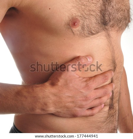 young man holding his sick stomach in pain