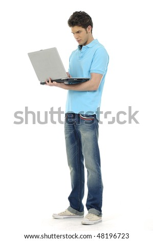 Young man holding laptop