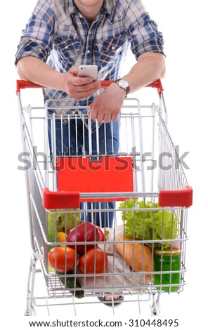 Young man holding mobile phone and shopping cart close up - stock photo