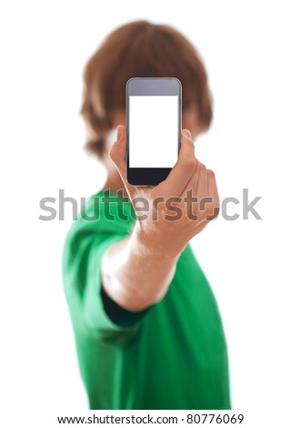 Young man holding modern phone, isolated on white [selective focus] - stock photo